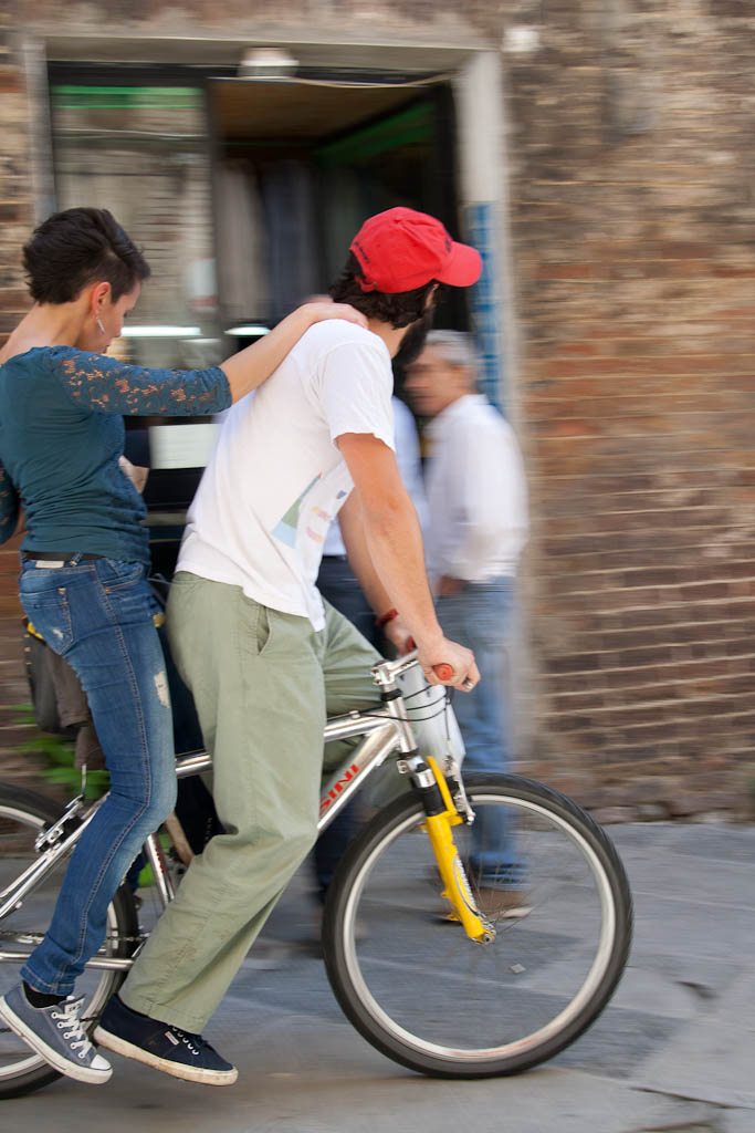 Couple on the bicycle in Italy