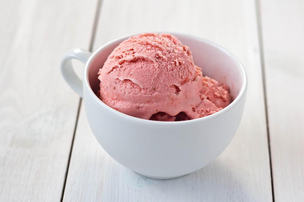 strawberry ice cream in a white cup